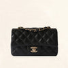 Chanel | Black Caviar Mini Rectangular Flap Bag with Light Gold Hardware - The-Collectory