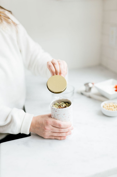 woman opening herbal tea with adaptogens