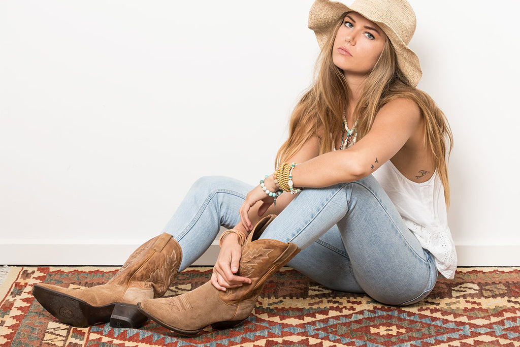 Model wearing Her Lovely Bones boho jewellery with cowboy boots