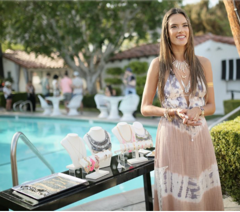 Alessandra Ambrosio with her collection of statement urban boho jewellery pieces to lift a simple outfit