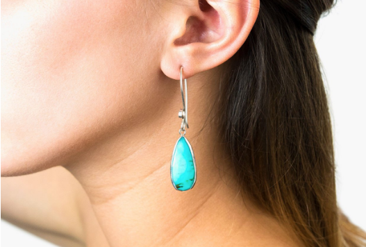 Turquoise earrings dangle on long sterling silver hooks