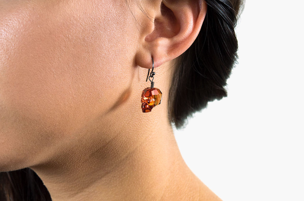 The Swarovski skull earring is available in stunning red magma crystal