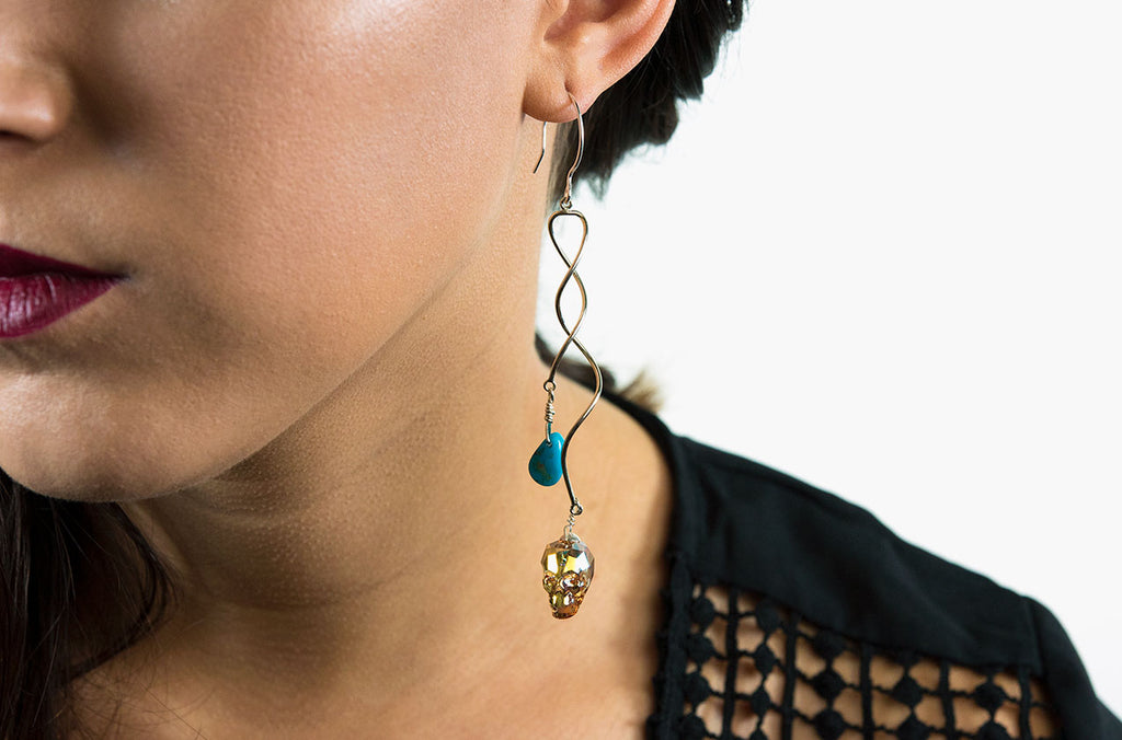 Swarovski skull earrings with turquoise dangle down to your shoulders on sterling silver swirls