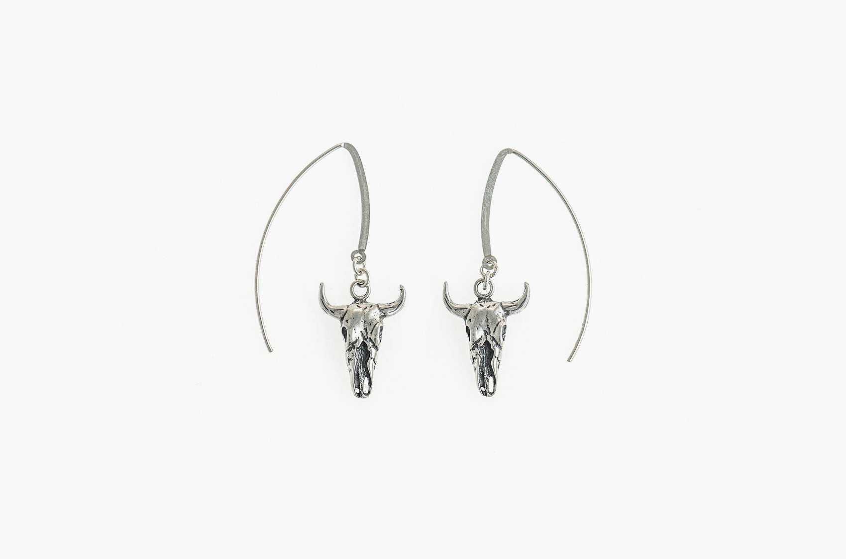 Artisan steer-skull earrings
