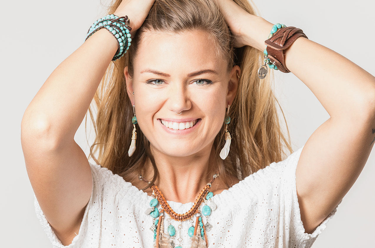 Blonde model wearing Bone & Stone. Tribal drop earrings