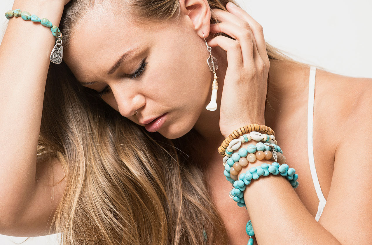 Blonde model wearing Stacked or Separate Bracelet Collection No 3.