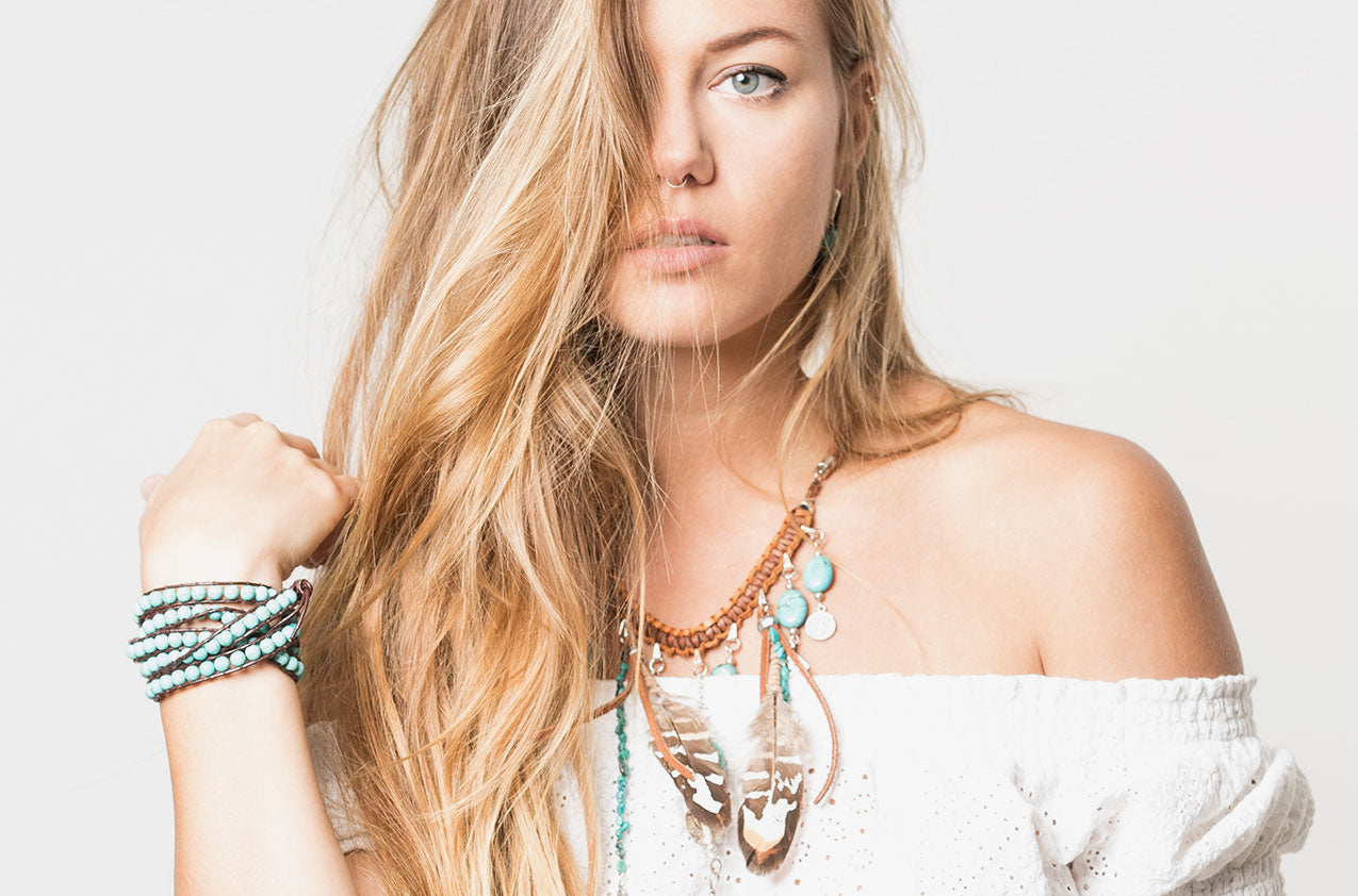 Blonde model wearing Turquoise wrap bracelet with brown leather
