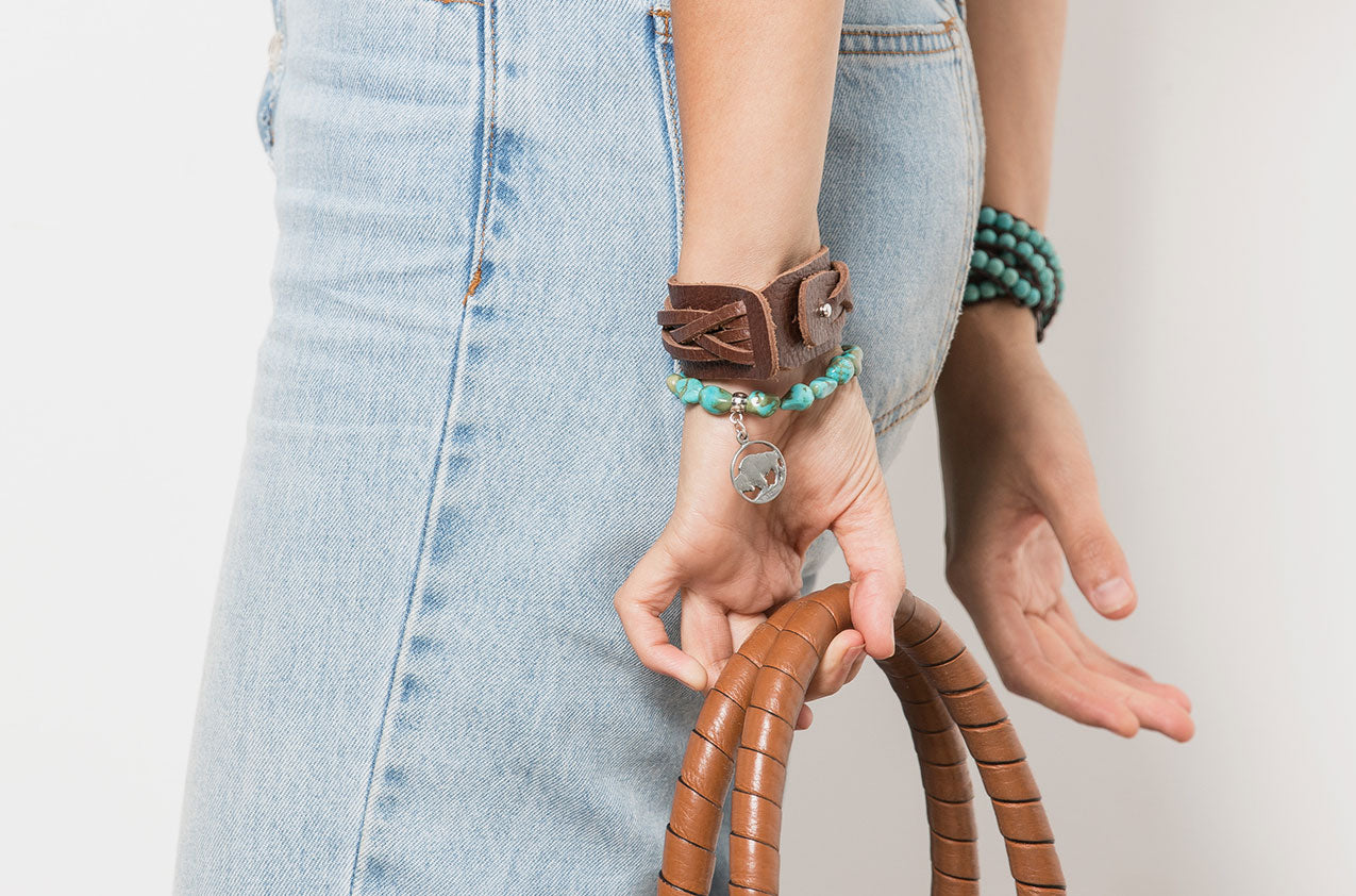Blonde model wearing Woven leather wide wristband bracelet