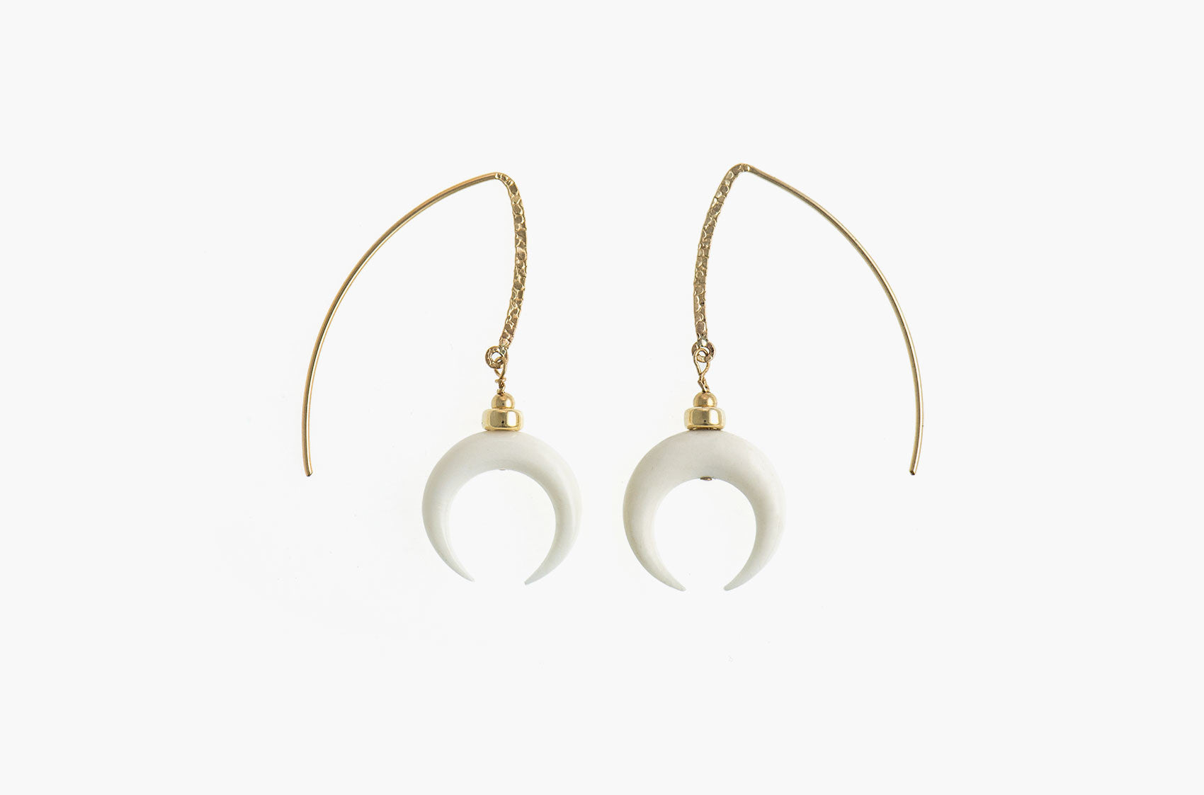Little Big Horn. Crescent medium drop earrrings Ivory with 14kt gold hammered earwires