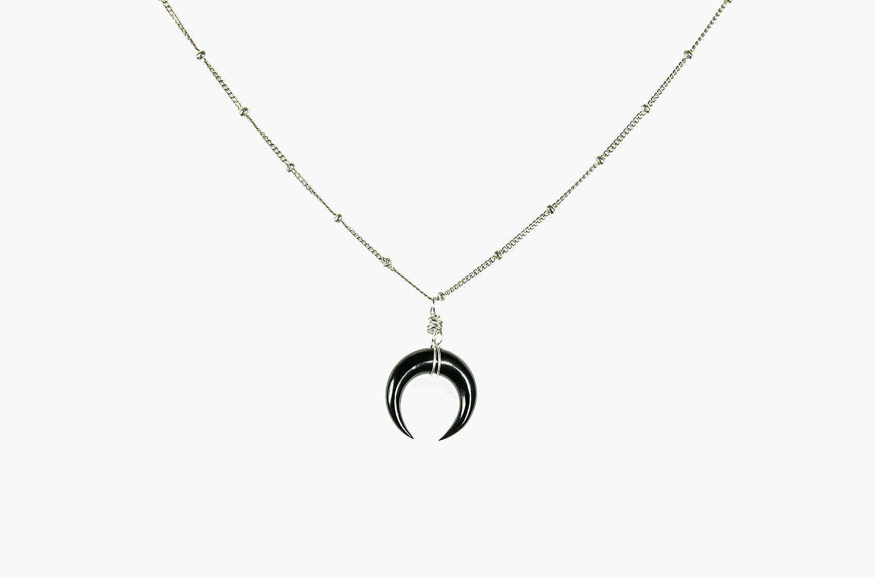 Little Big Horn. Mini crescent necklace black with silver