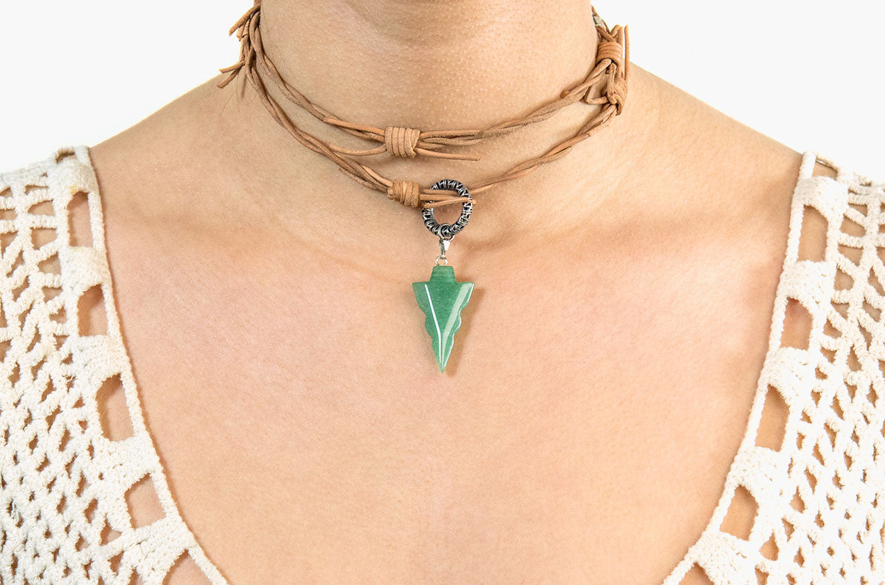 Model wearing Barbed leather wrap necklace with jade arrow pendant
