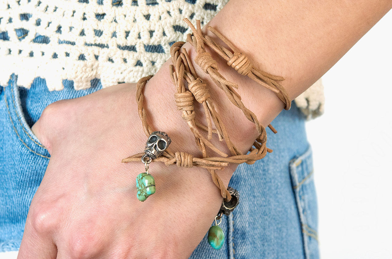 Model wearing Barbed-wire leather, turquoise and skull wrap bracelet