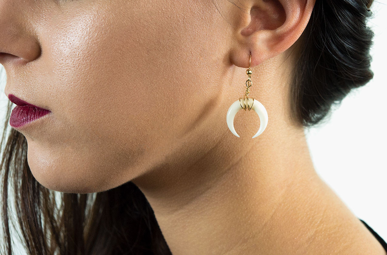 Model wearing Little Big Horn. Crescent medium wire-wrap earrings Ivory with 14kt gold smooth earwires