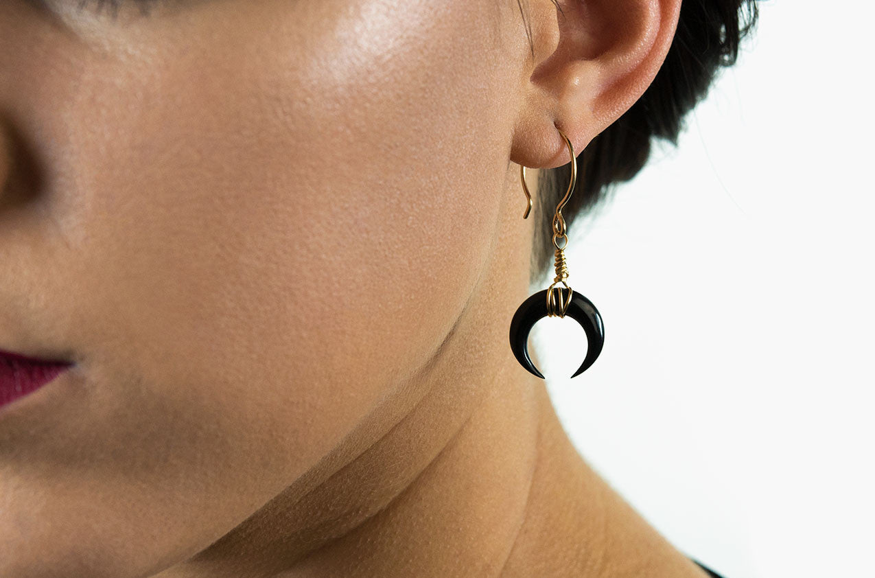 Model wearing Little Big Horn. Crescent mini wire-wrap earrings Black with 14kt gold-filled earwires