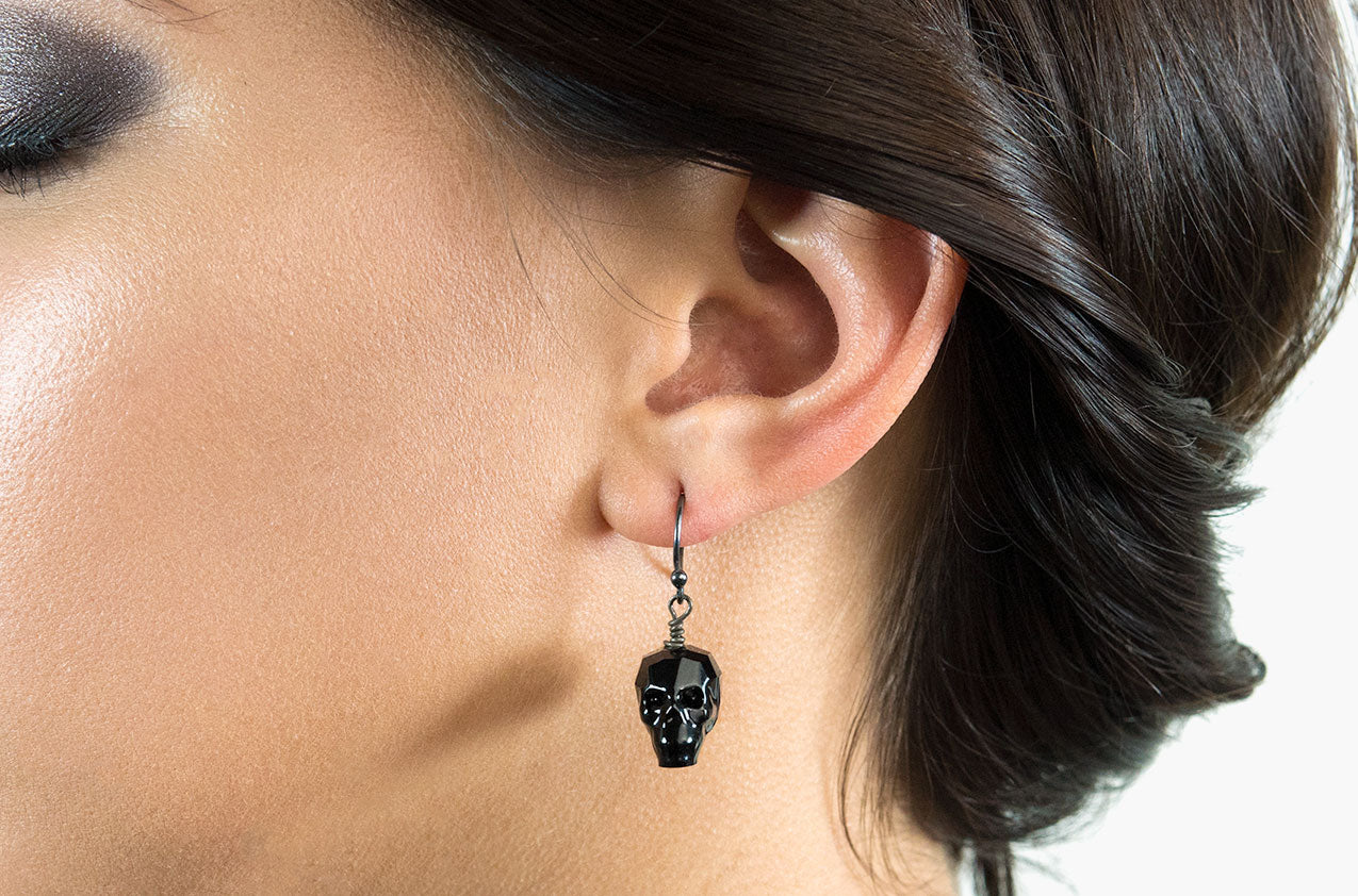 Model wearing Lovely Bones Swarovski Skull earrings Jet Black with sterling silver earwires
