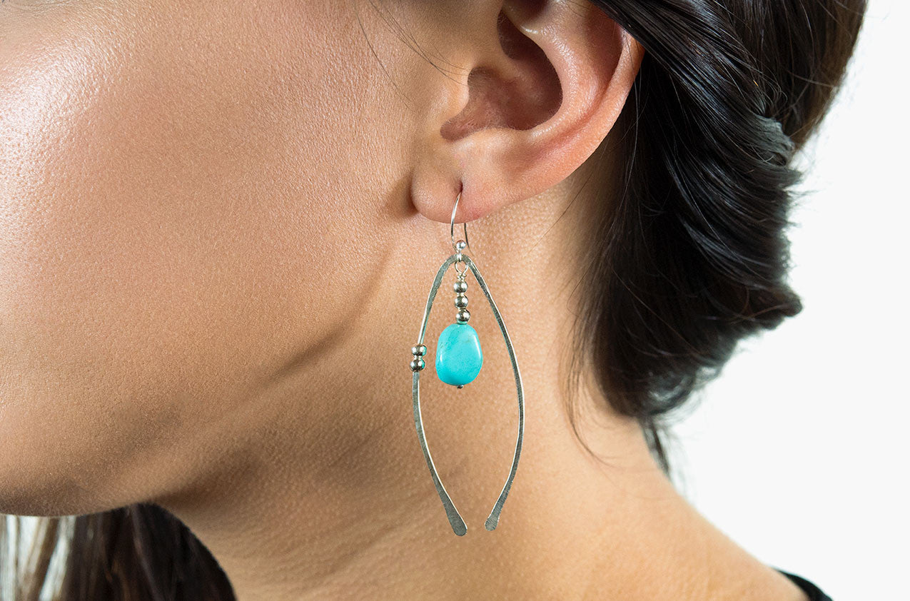 Model wearing Metal & Stone. Artisan arches earrings Copper/silver earwires All sterling silver earwires