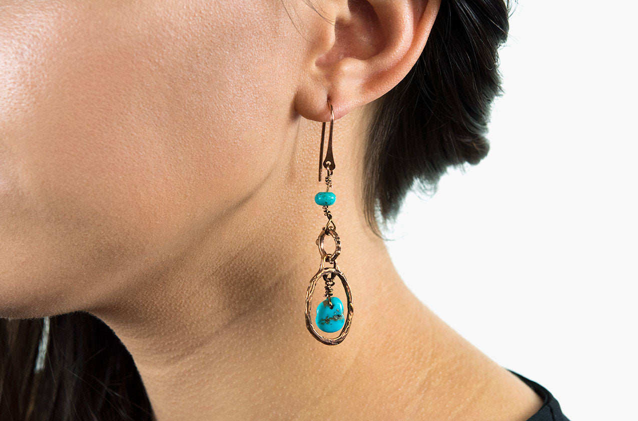 Model wearing Metal & Stone. Artisan bronze earrings