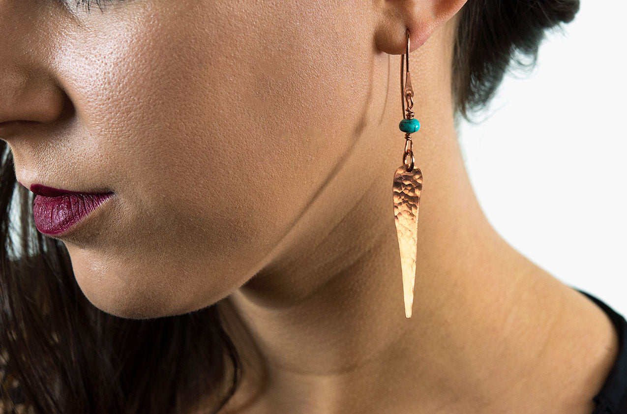 Model wearing Metal & Stone. Artisan talon earrings