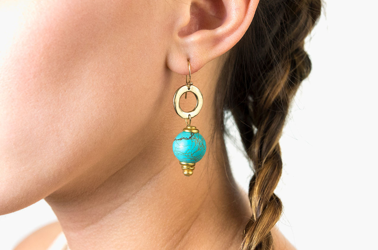 Model wearing Metal & Stone. Petite turquoise earrings
