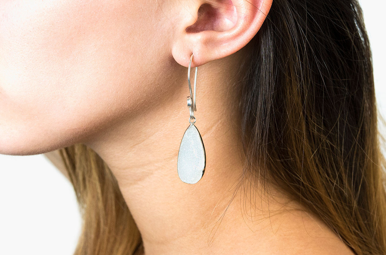 Model wearing Silver & Stone. Druzy drop earrings