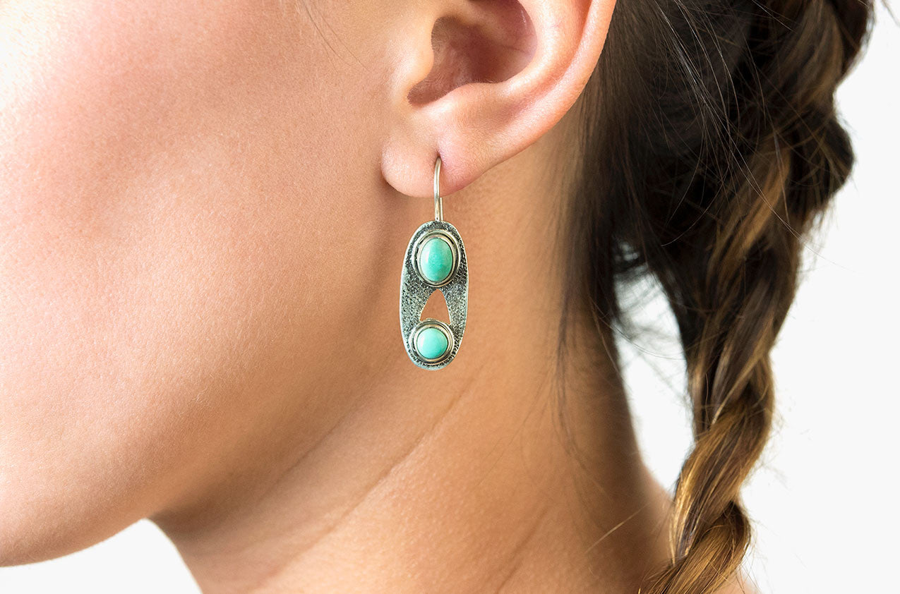 Model wearing Silver & Stone. Oval turquoise earrings