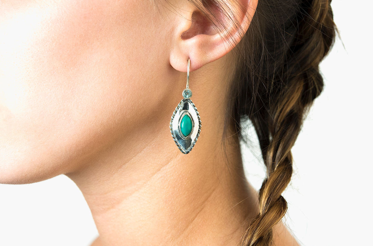 Model wearing Silver & Stone. Topaz and turquoise earrings