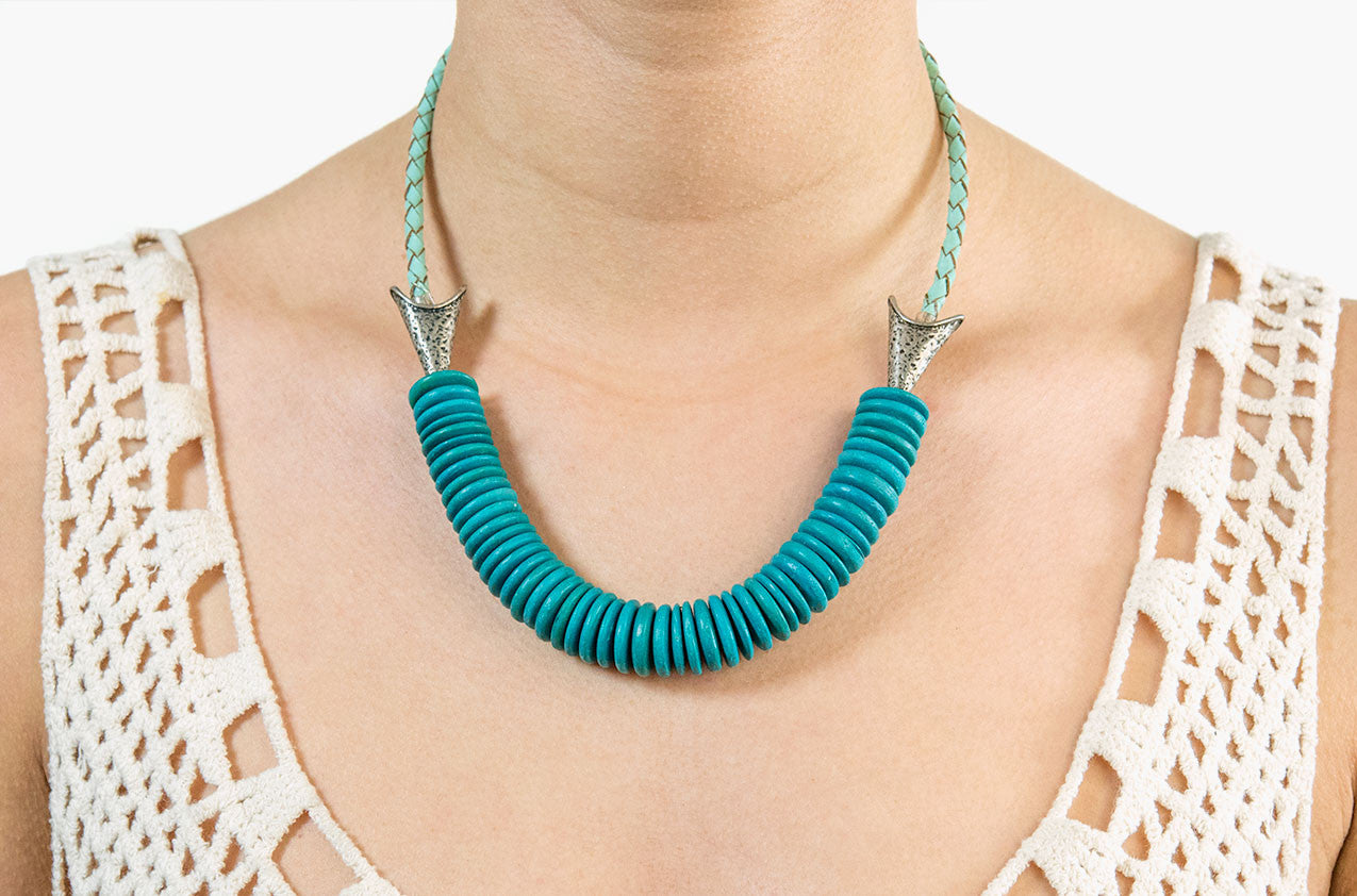 Model wearing Leather and turquoise wood arrow necklace