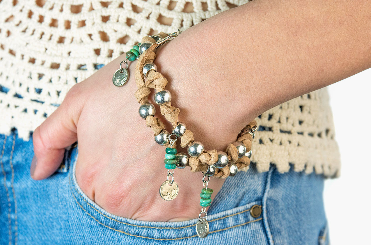 Model wearing Leather, turquoise and coin wrap bracelet