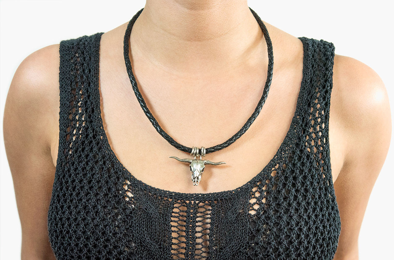 Model wearing Long-horn & Leather. Sterling steer necklace in black