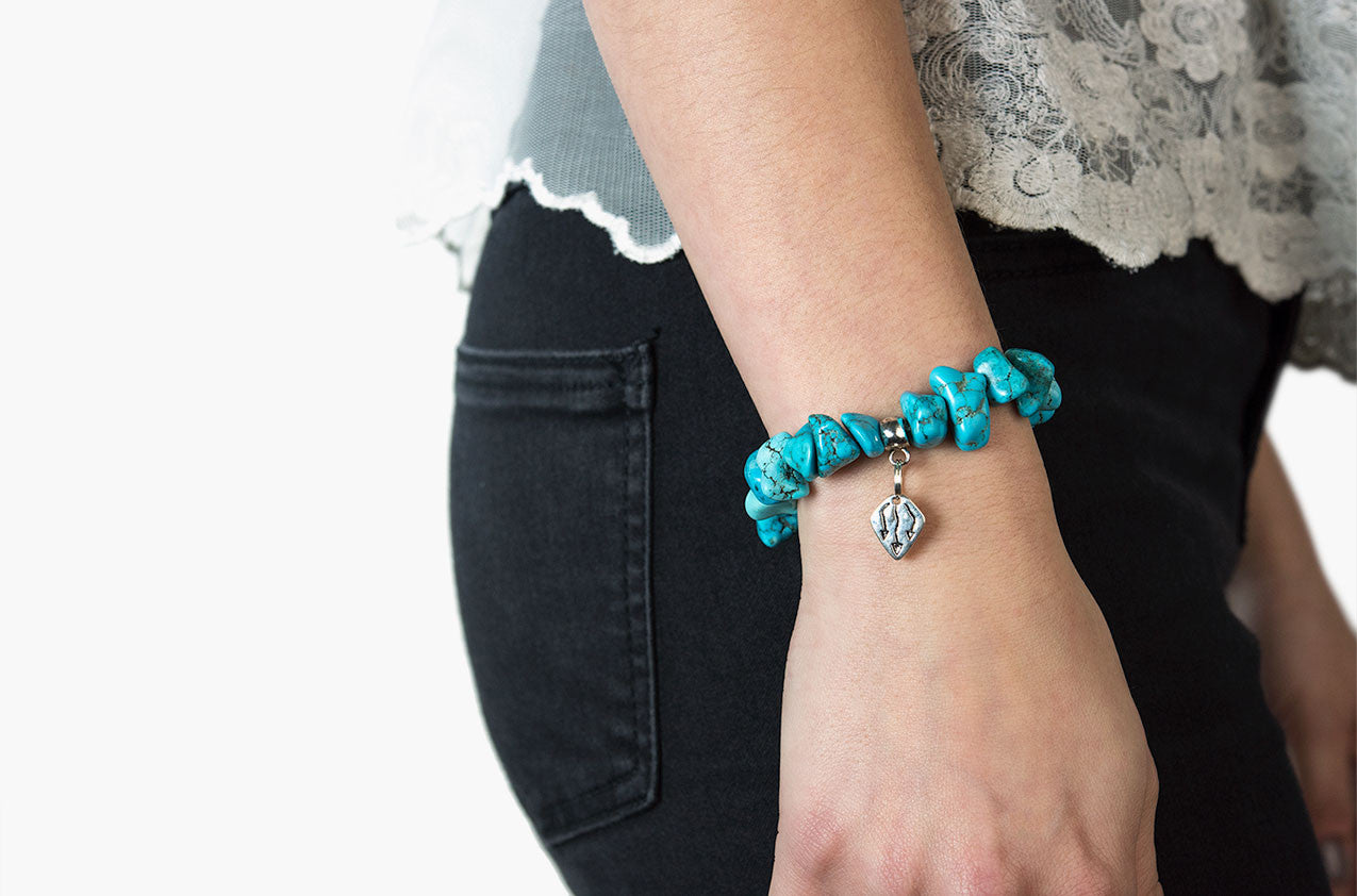 Model wearing Pewter & Stone. Turquoise and pewter bracelet
