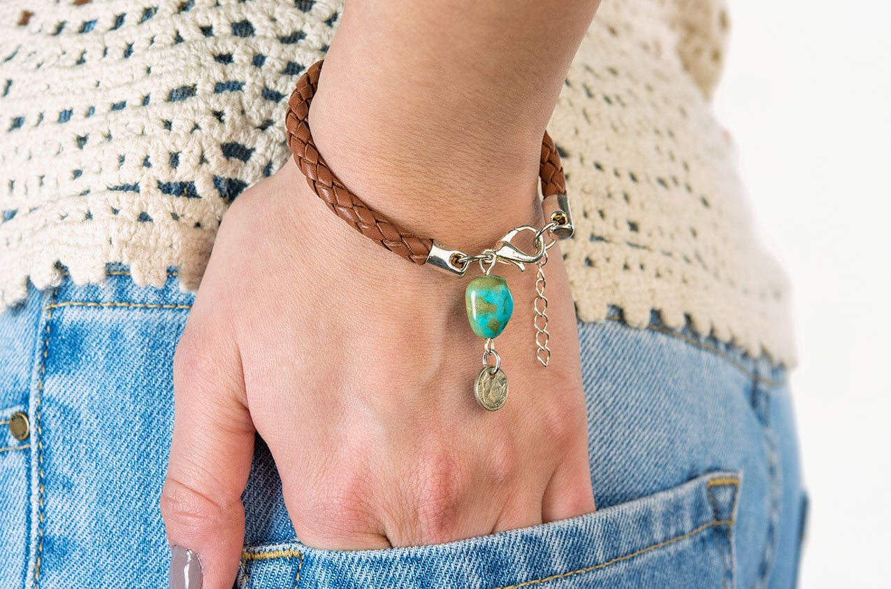 Model wearing Plaited leather and turquoise bracelet