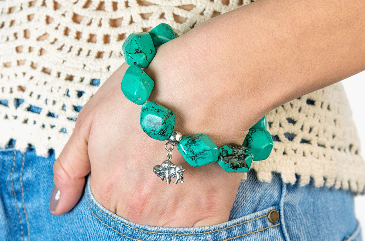 Model wearing Serious Rocks. Super-size turquoise chunks bracelet