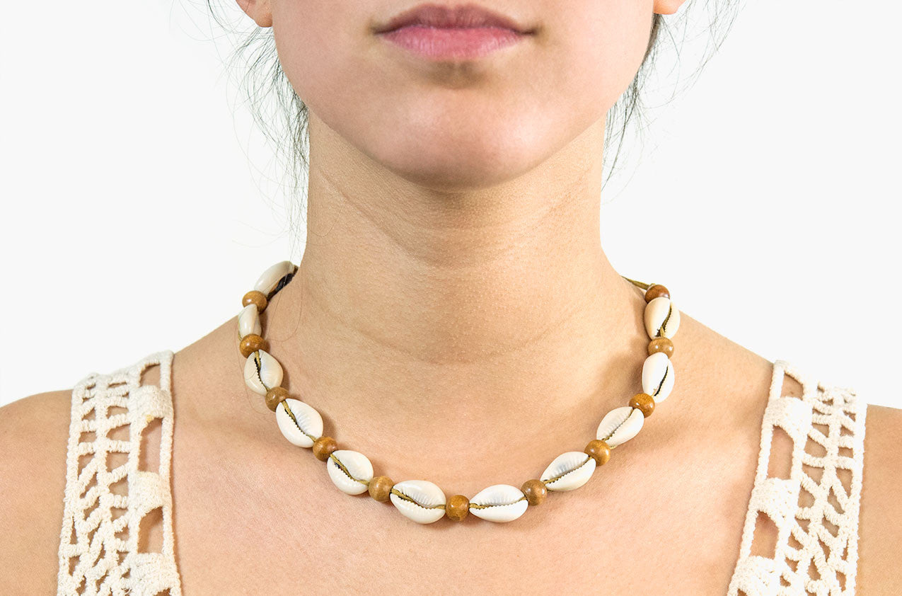 Model wearing Shell and wood necklace