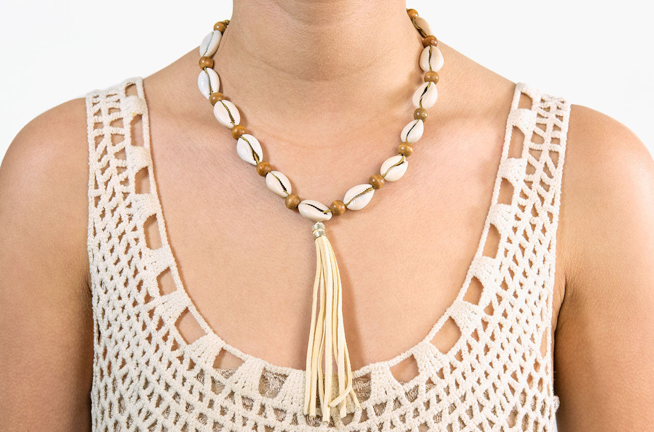 Model wearing Shell, wood and tassel leather necklace