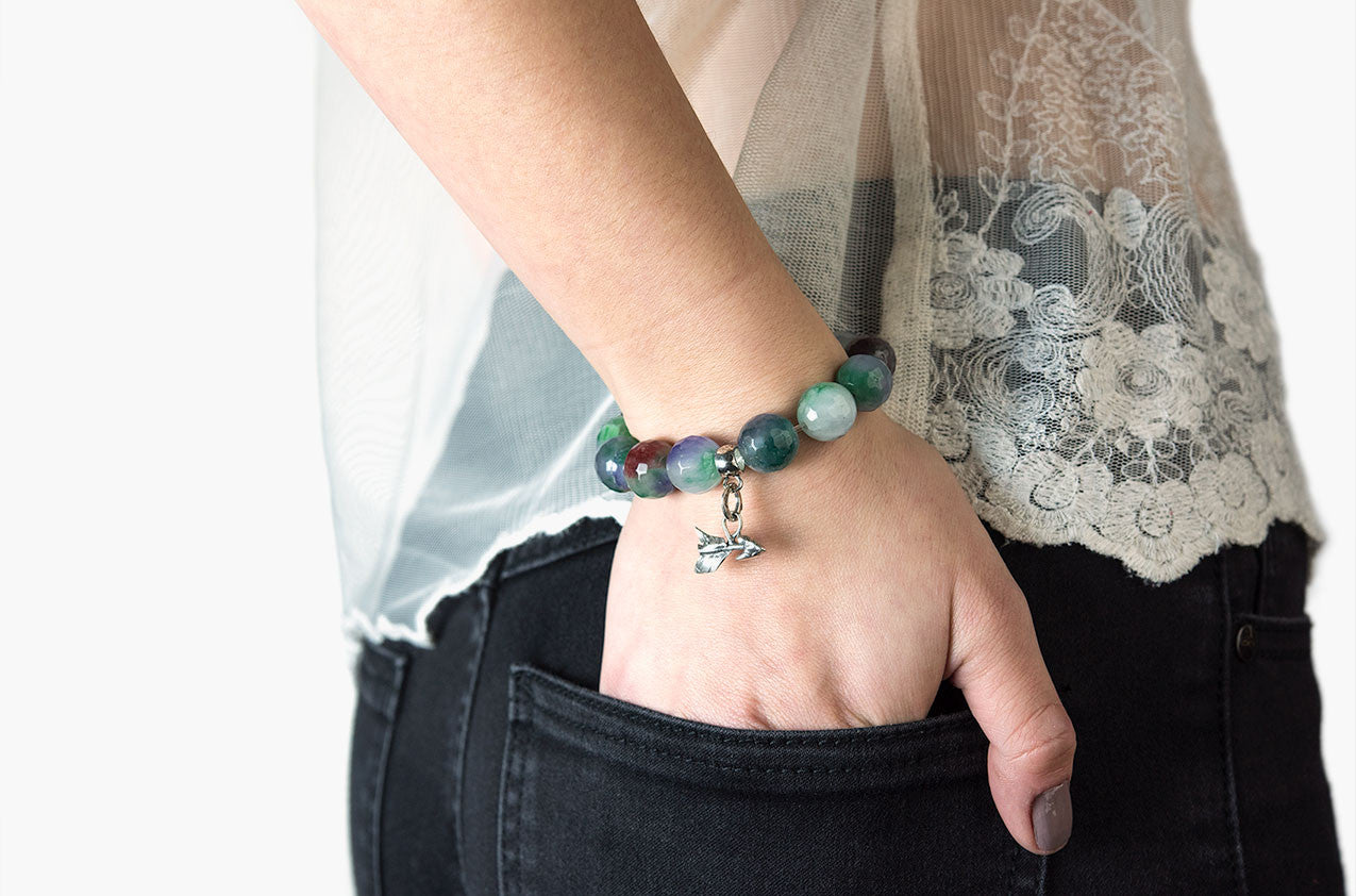 Model wearing Silver & Stone. Green Malay jade and silver bracelet