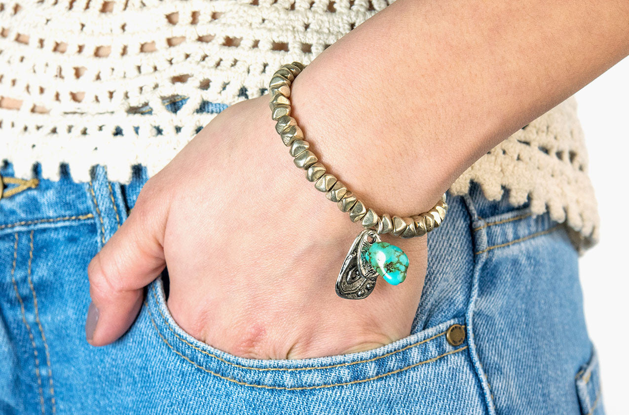 Model wearing Silver nuggets, turquoise and charms bracelet