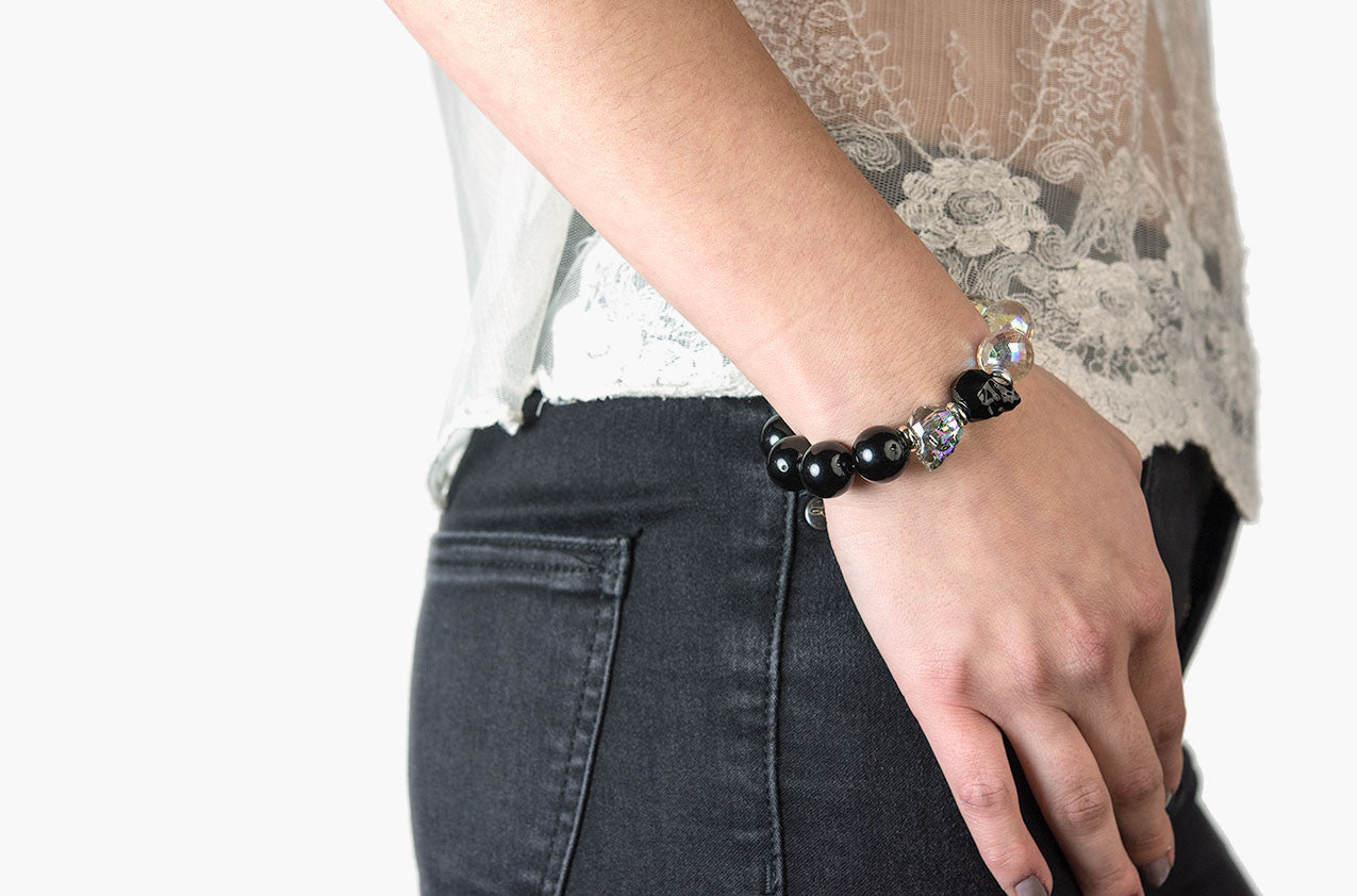 Model wearing Skull & Stone. Onyx, crystal and silver bracelet