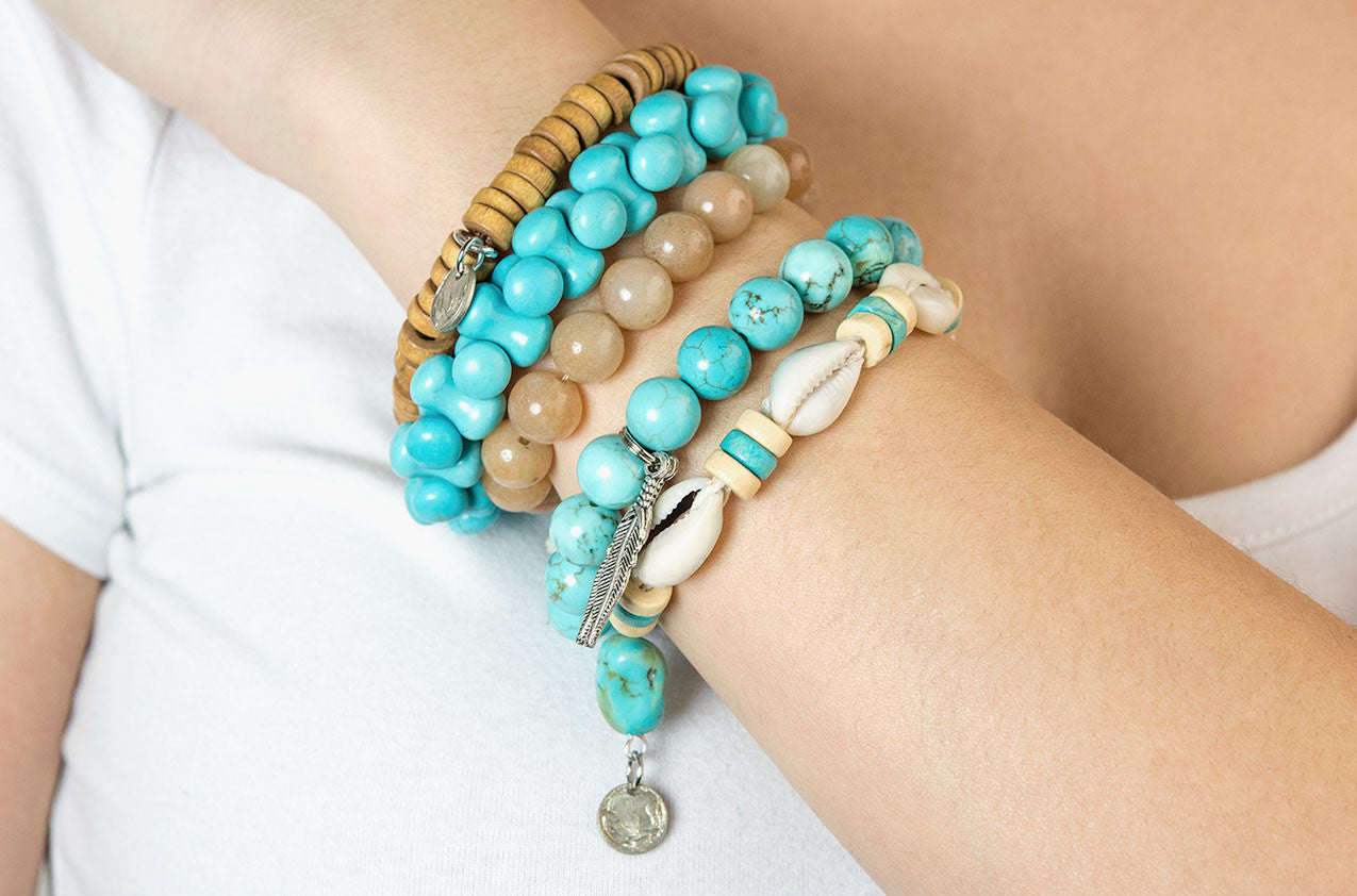 Model wearing Stacked or Separate Bracelet Collection No 3.