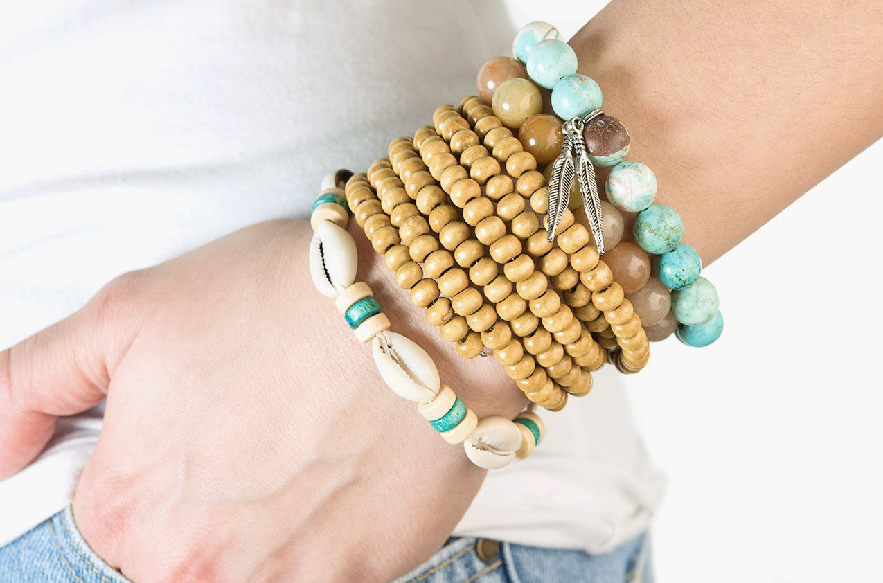Model wearing Stacked or Separate Bracelet Collection No. 5