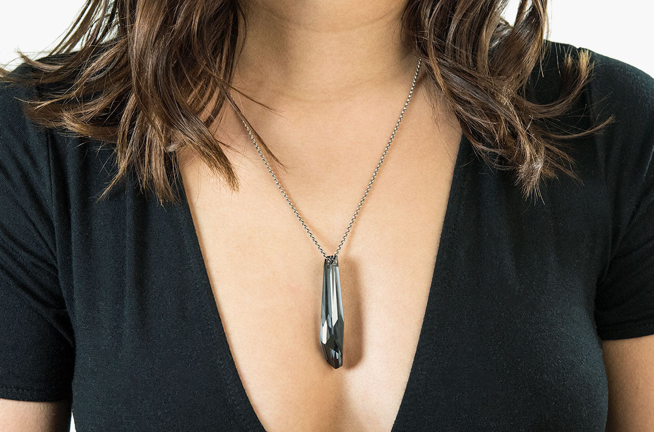 Model wearing Swarovski Hanging Rock pendant silver night