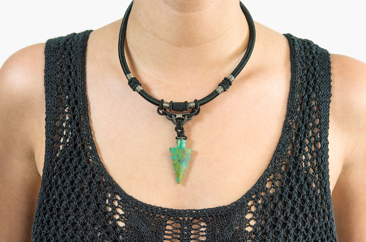 Model wearing Tribal woven necklace with jade arrow pendant