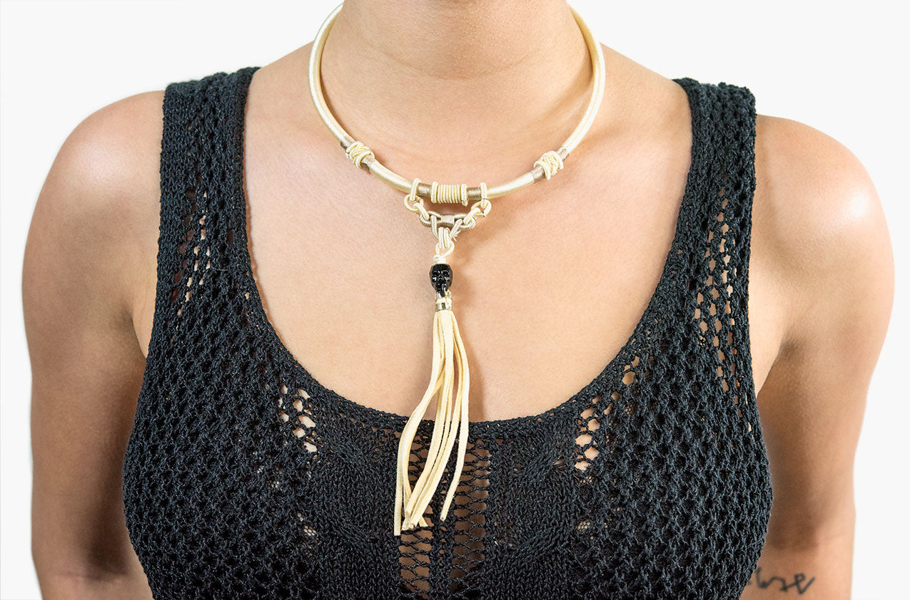 Model wearing Tribal woven necklace with skull and tassel