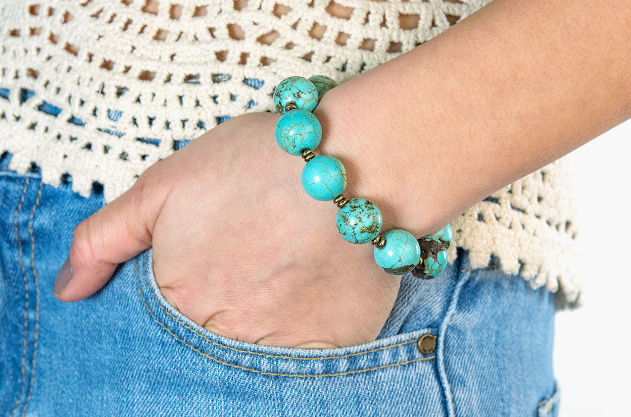 Model wearing Turquoise and brass bracelet