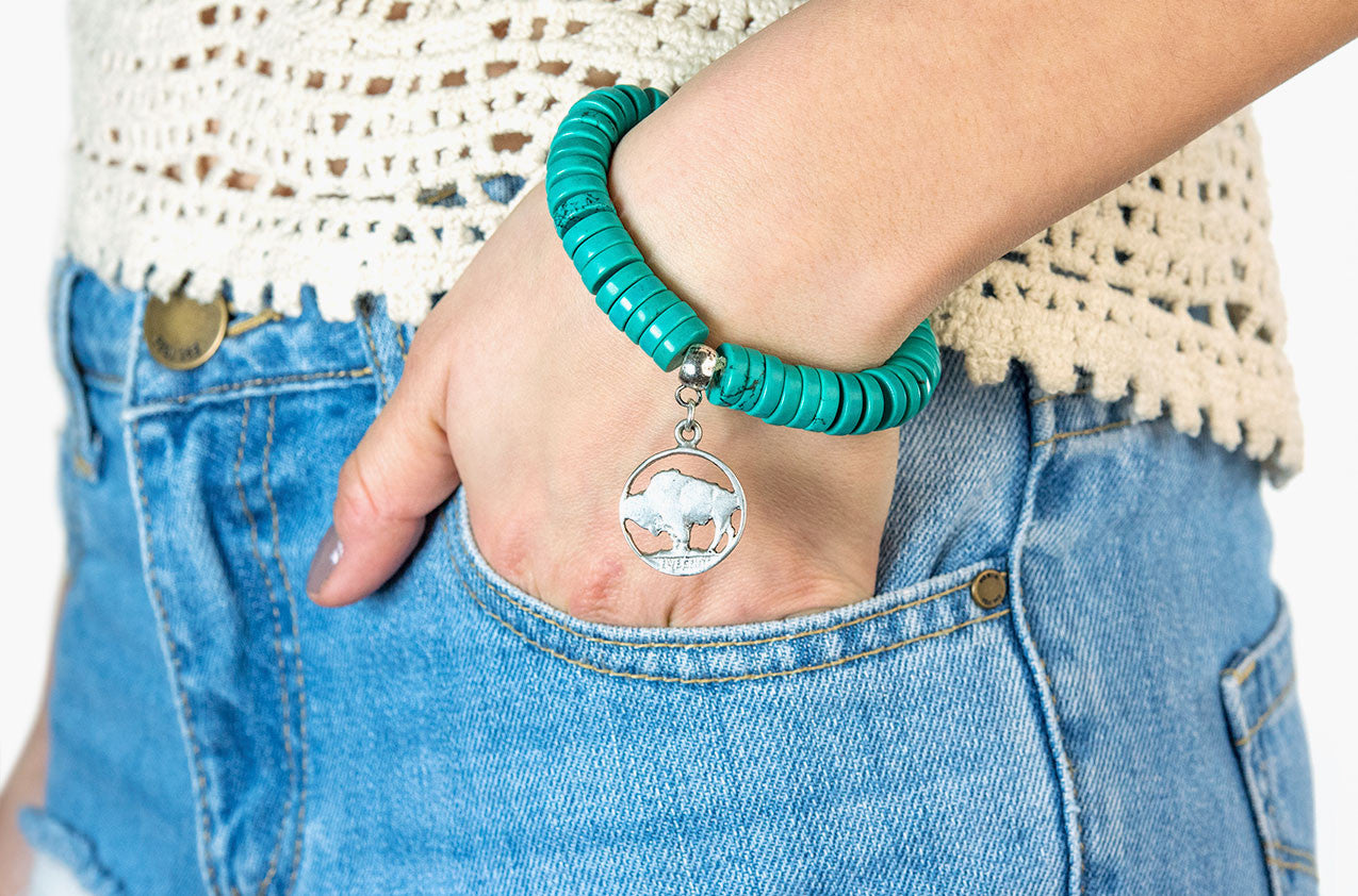 Model wearing Turquoise and buffalo coin charm bracelet