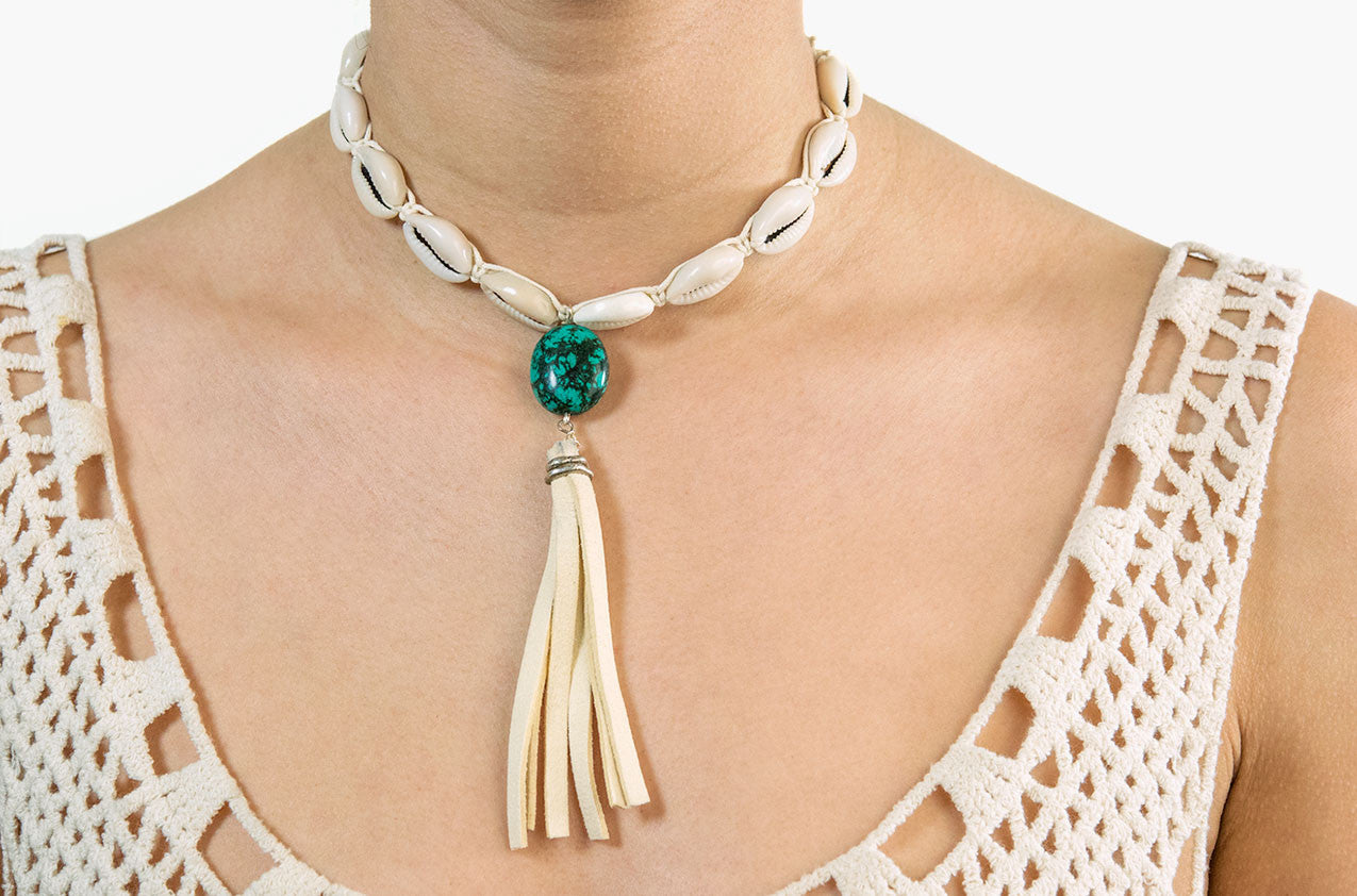 Model wearing Turquoise & Tassel. Shell and leather necklace