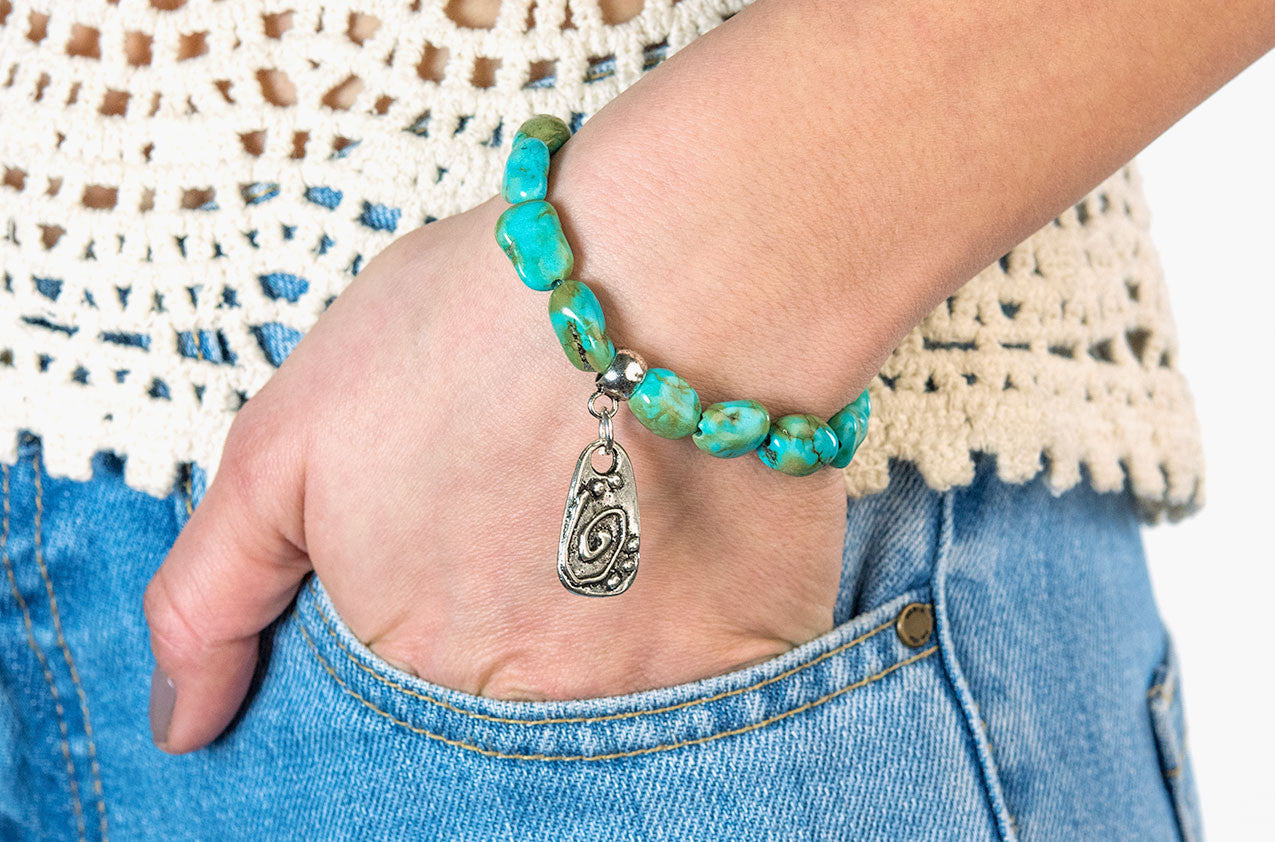 Model wearing Turquoise nuggets and tribal charm bracelet