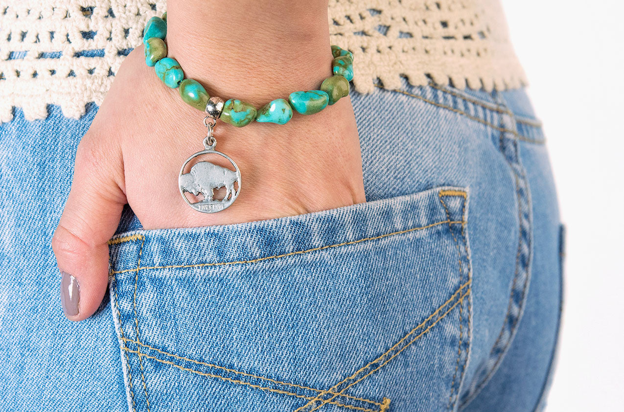 Model wearing Turquoise nuggets with buffalo charm bracelet