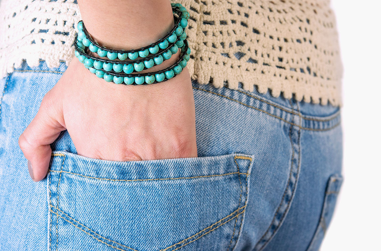 Model wearing Turquoise wrap bracelet with black leather