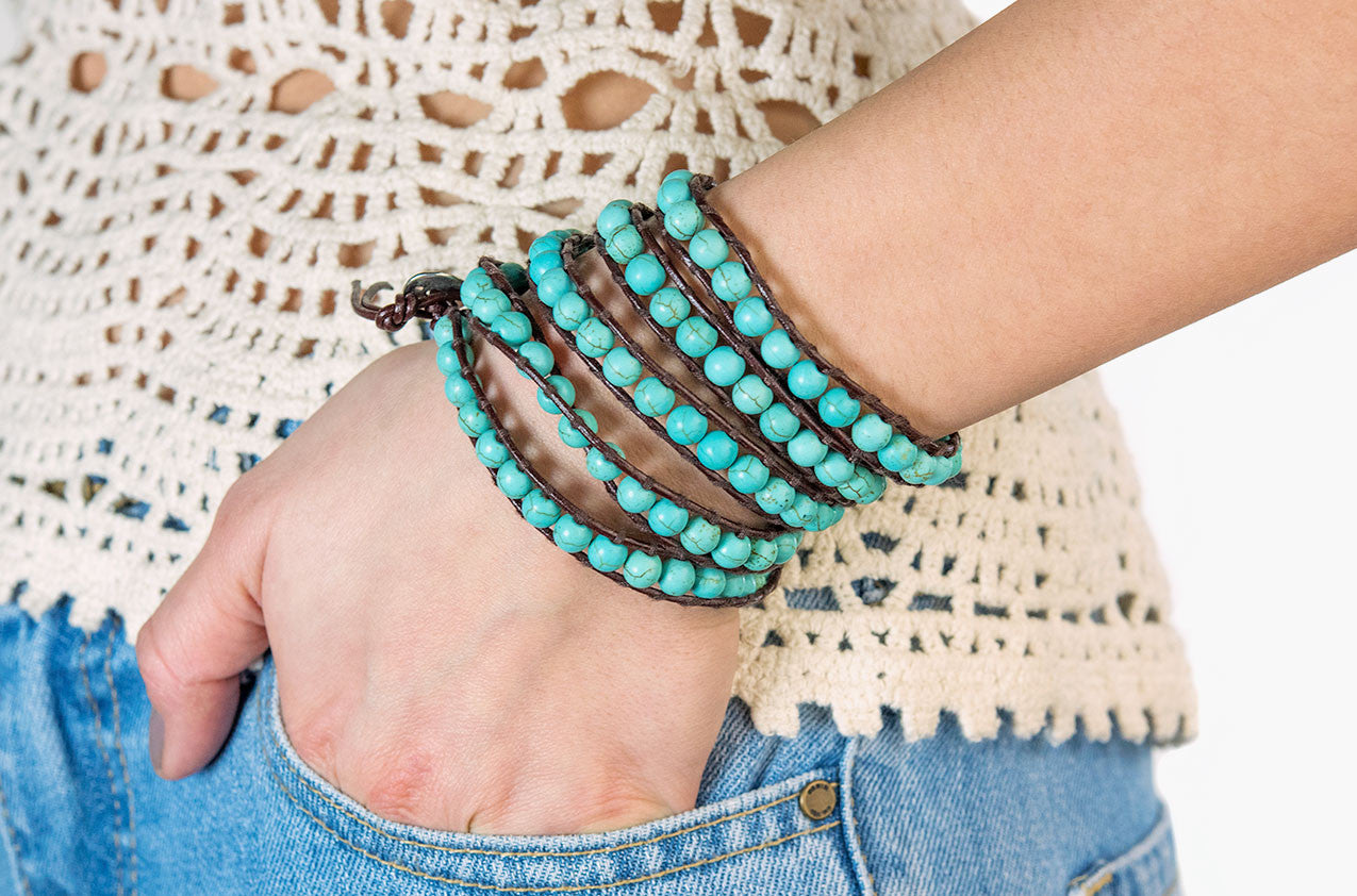 Model wearing Turquoise wrap bracelet with brown leather