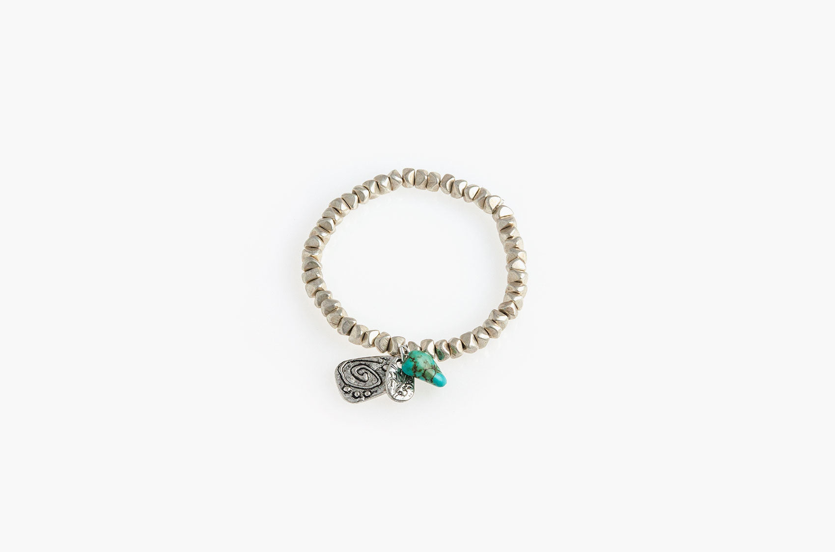 Silver nuggets, turquoise and charms bracelet